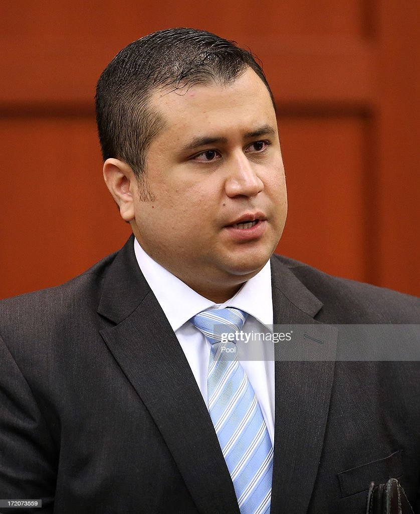 George Zimmerman talks to court personnel during a recess on the 16th day of his trial in Seminole circuit court July 1, 2013 in Sanford, Florida. Zimmerman is charged with second-degree murder for the February 2012 shooting death of 17-year-old Trayvon Martin.
