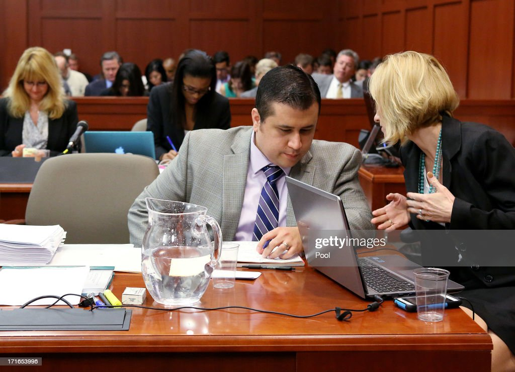 George Zimmerman (2nd R) talks to defense attorney Lorna Truett (R) during Zimmerman's murder trial June 27, 2013 in Sanford, Florida. Zimmerman is charged with second-degree murder for the February 2012 shooting death of 17-year-old Trayvon Martin.