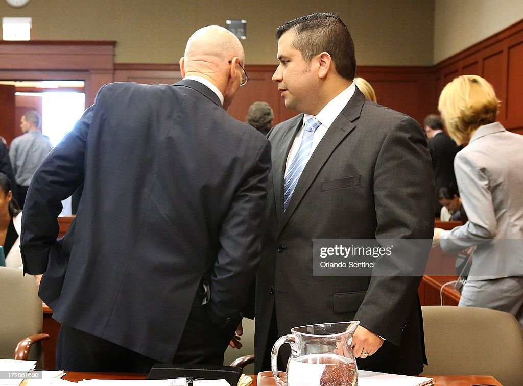 George Zimmerman talks with defense attorney Don West during his trial in Sanford, Florida, Monday, July 1, 2013. Zimmerman is accused in the fatal shooting of Trayvon Martin.