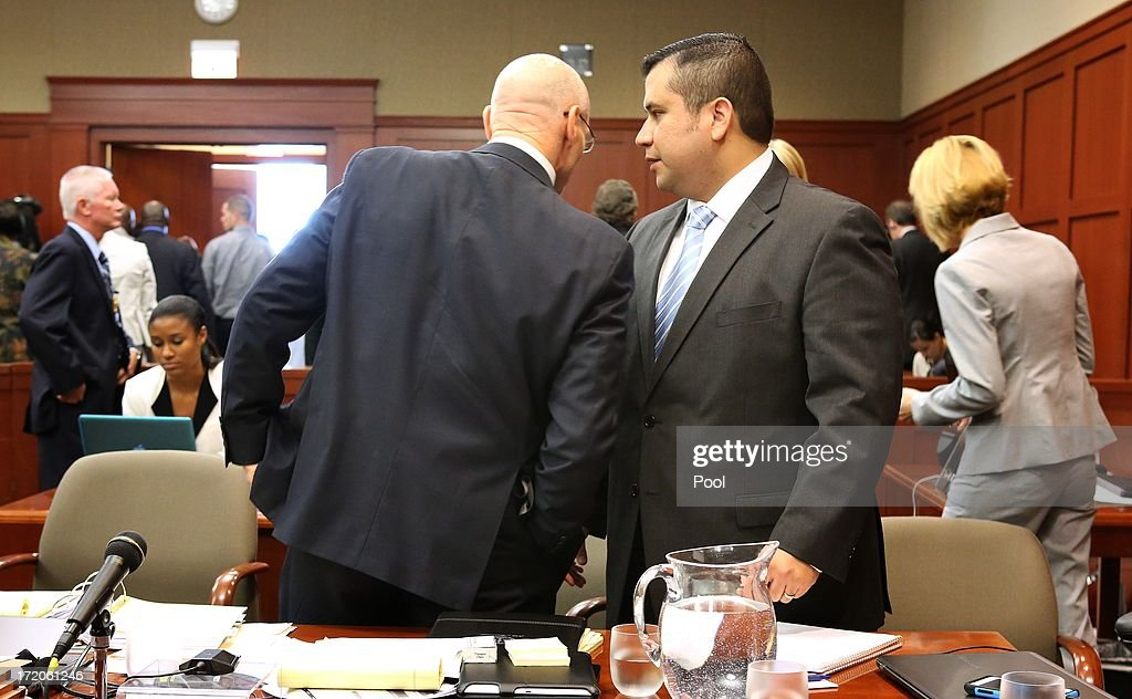 George Zimmerman (R) talks with defense attorney Don West on the 16th day of his trial in Seminole circuit court, July 1, 2013 in Sanford, Florida. Zimmerman is charged with second-degree murder for the February 2012 shooting death of 17-year-old Trayvon Martin.