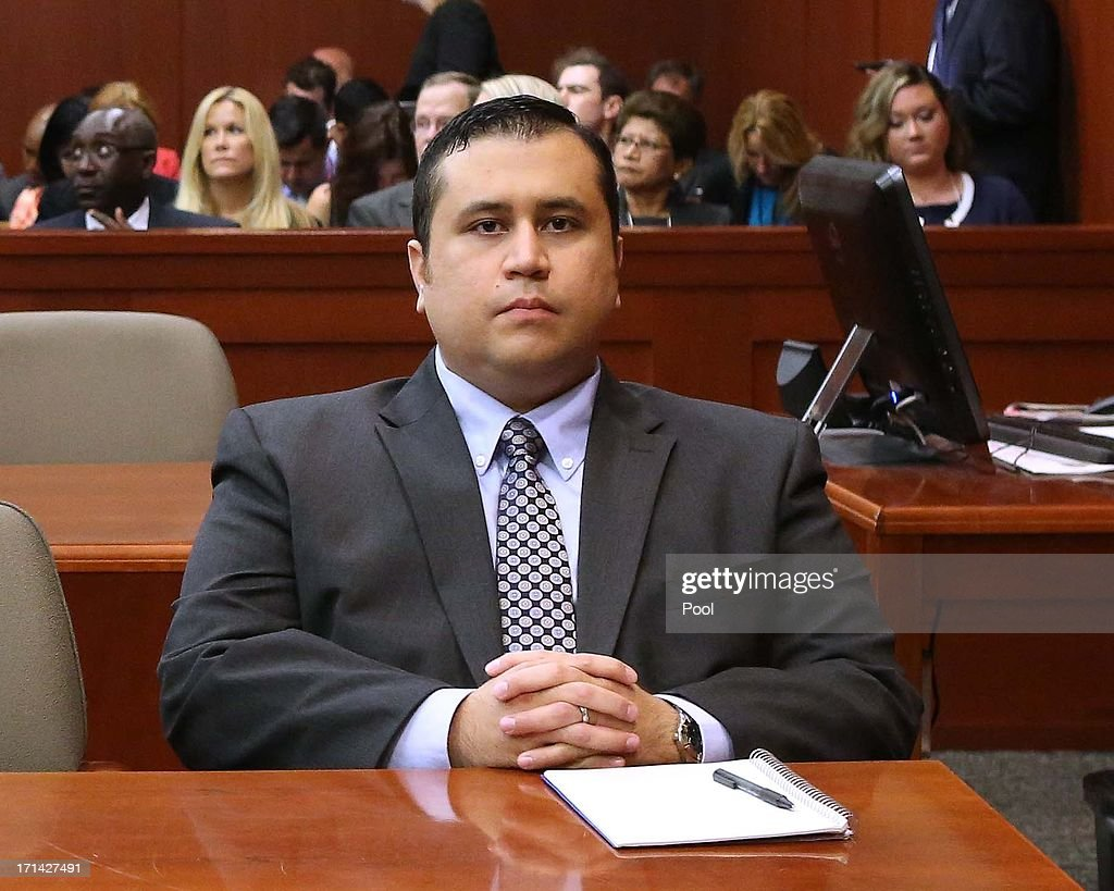 <a gi-track='captionPersonalityLinkClicked' href=/galleries/search?phrase=George+Zimmerman&family=editorial&specificpeople=9042868 ng-click='$event.stopPropagation()'>George Zimmerman</a> waits for his defense counsel to arrive in Seminole circuit court, on the 11th day of his trial June 24, 2013 in Sanford, Florida. Today prosecutors began with their opening statements. Zimmerman is charged with second-degree murder for the February 2012 shooting death of 17-year-old Trayvon Martin.
