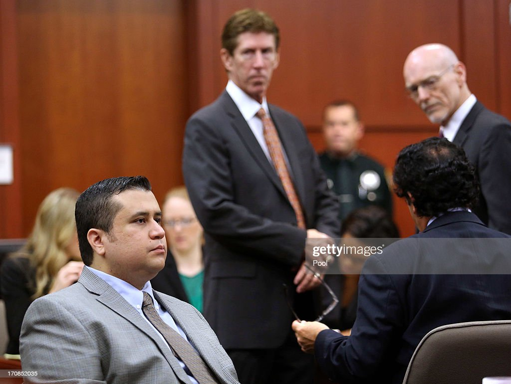 George Zimmerman waits for the jury pool to arrive, with his defense team on the eighth day of his trial in Seminole circuit court June 19, 2013 in Sanford, Florida. Zimmerman is charged with second-degree murder for the February 2012 shooting death of 17-year-old Trayvon Martin.