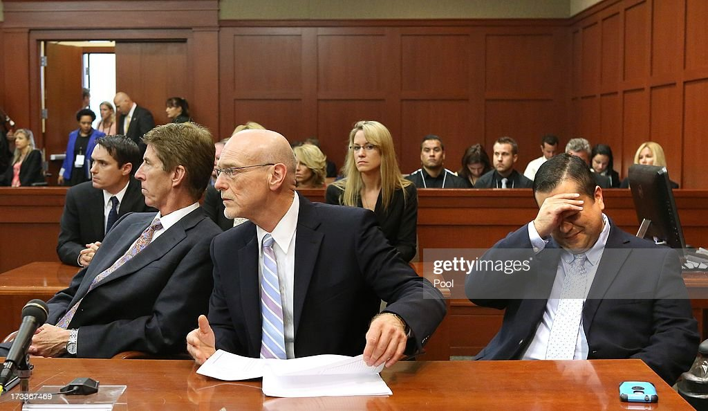 <a gi-track='captionPersonalityLinkClicked' href=/galleries/search?phrase=George+Zimmerman&family=editorial&specificpeople=9042868 ng-click='$event.stopPropagation()'>George Zimmerman</a> wipes his face as Defense counsel Mark O'Mara and Don West wait for the judge to arrive at the end of the day, at the Seminole County Criminal Justice Center, July 12, 2013 in Sanford, Florida. Judge Debra Nelson has ruled that the jury can also consider a lesser manslaughter charge along with the second-degree murder charge in the shooting death of Trayvon Martin.