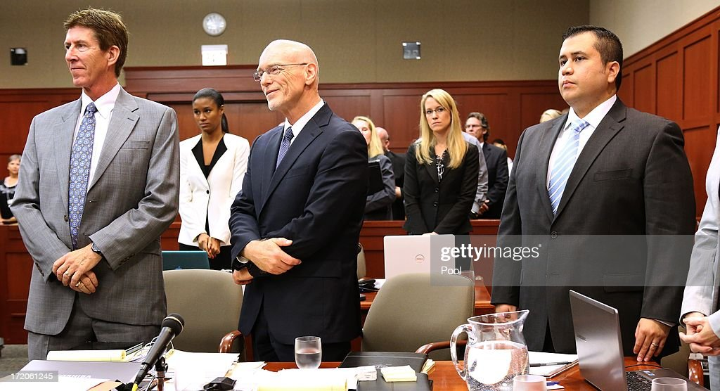 George Zimmerman, (R) with his attorneys, Mark O'Mara (left), and Don West, watch as the jury enter the courtroom during the 16th day of his trial in Seminole circuit court, July 1, 2013 in Sanford, Florida. Zimmerman is charged with second-degree murder for the February 2012 shooting death of 17-year-old Trayvon Martin.