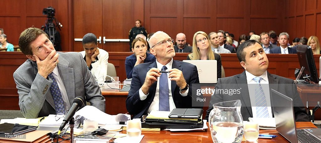 George Zimmerman, with his attorneys, Mark O'Mara (left), and Don West, watch as an evidence video is projected during the 16th day of his trial in Seminole circuit court July 1, 2013 in Sanford, Florida. Zimmerman is charged with second-degree murder for the February 2012 shooting death of 17-year-old Trayvon Martin.