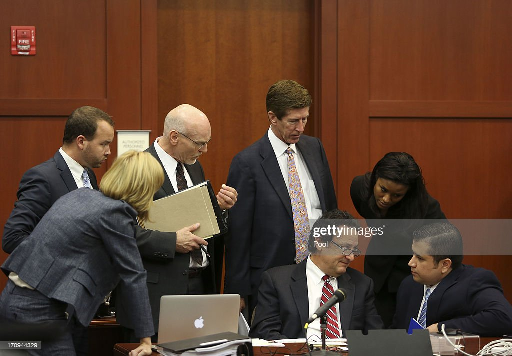 George Zimmerman's defense team confers with him during the final stages of jury selection for his trial in Seminole circuit court June 20, 2013 in Sanford, Florida. Zimmerman is charged with second-degree murder for the February 2012 shooting death of 17-year-old Trayvon Martin.