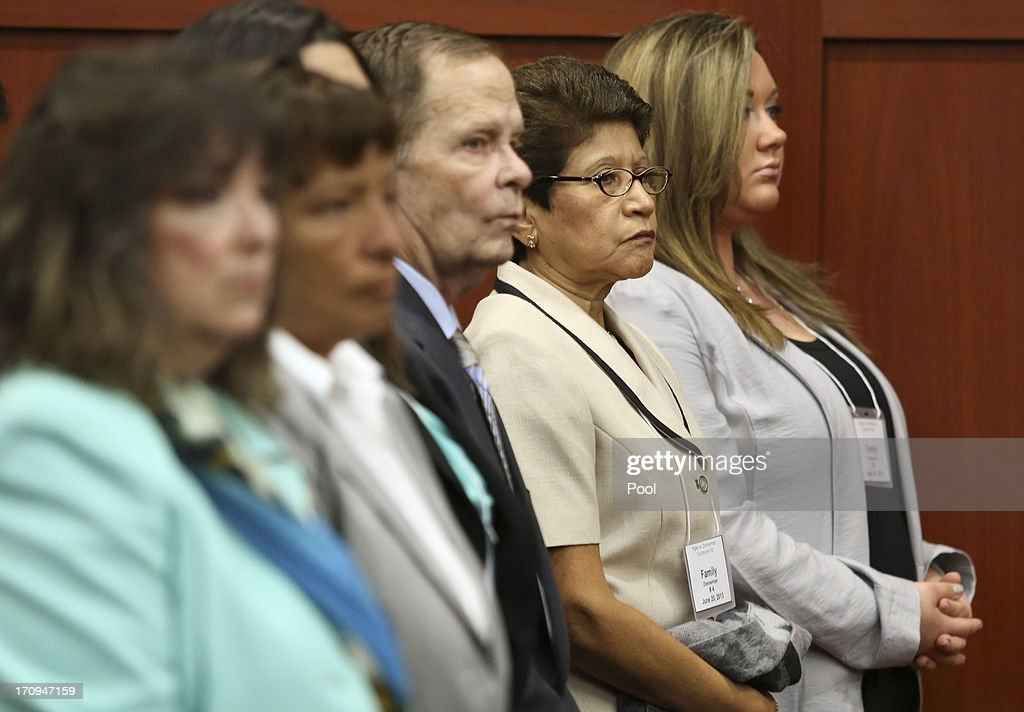 George Zimmerman's family stands as the selected jurors enter the courtroom during his trial in Seminole circuit court June 20, 2013 in Sanford, Florida. Zimmerman is charged with second-degree murder for the February 2012 shooting death of 17-year-old Trayvon Martin.