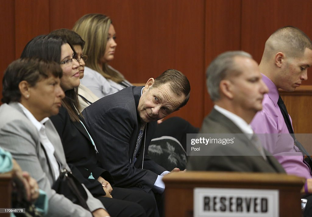 George Zimmerman's father Robert Zimmerman Sr. is surrounded by family during the final stages of jury selection for his trial in Seminole circuit court June 20, 2013 in Sanford, Florida. Zimmerman is charged with second-degree murder for the February 2012 shooting death of 17-year-old Trayvon Martin.