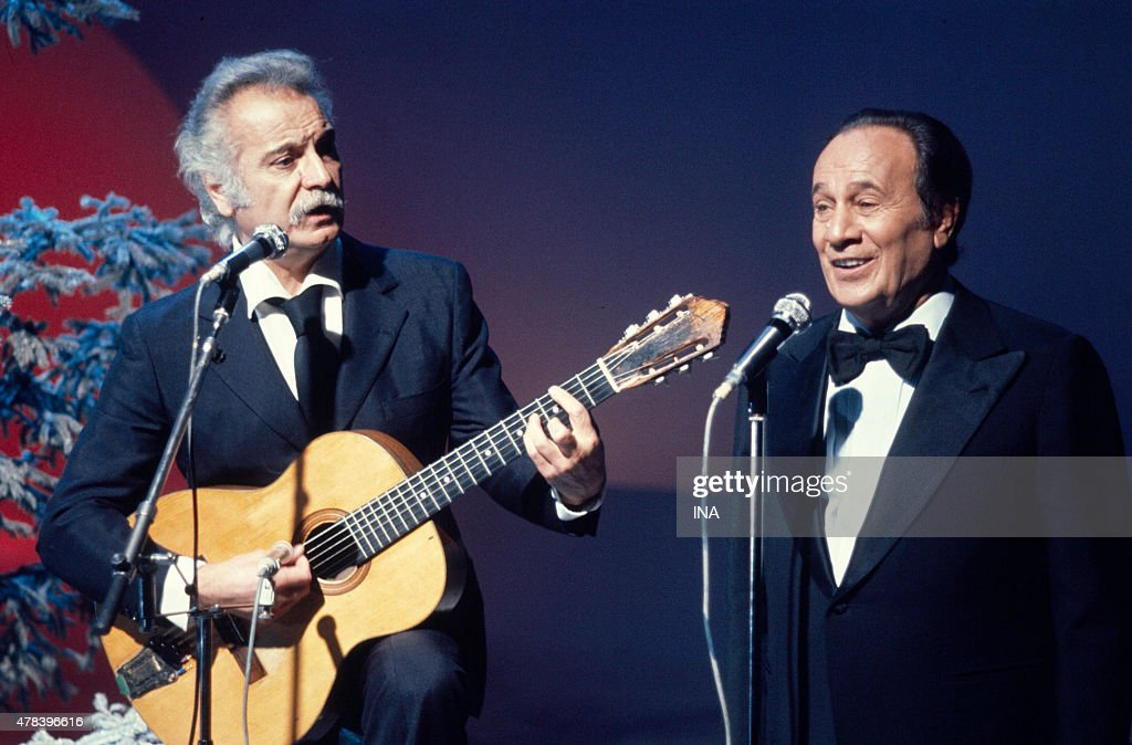 <a gi-track='captionPersonalityLinkClicked' href=/galleries/search?phrase=Georges+Brassens&family=editorial&specificpeople=882384 ng-click='$event.stopPropagation()'>Georges Brassens</a> and Tino Rossi in duet during the recording of the program ''Number one'' realized by Marion Sarraut