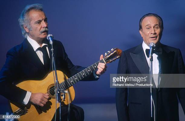 Georges Brassens and Tino Rossi perform together during a television show broadcast