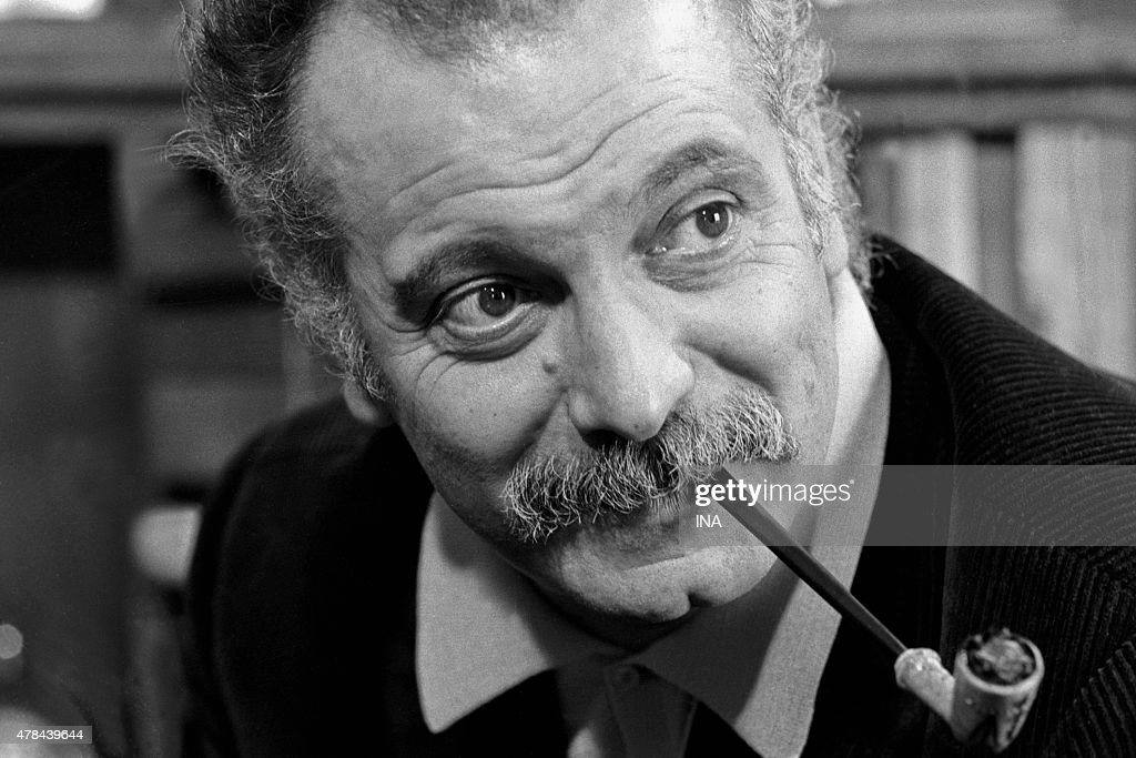 <a gi-track='captionPersonalityLinkClicked' href=/galleries/search?phrase=Georges+Brassens&family=editorial&specificpeople=882384 ng-click='$event.stopPropagation()'>Georges Brassens</a> interviewed in the program ''library of pocket'' dedicated to the writer Paul Leautaud
