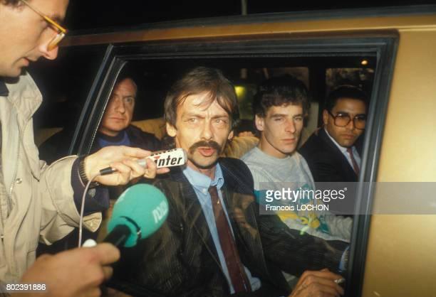 Georges Courtois Patrick Thiolet et Abdelkarim Khalki après leur arrestation lors de la prise d'otages du palais de justice de Nantes le 20 décembre...