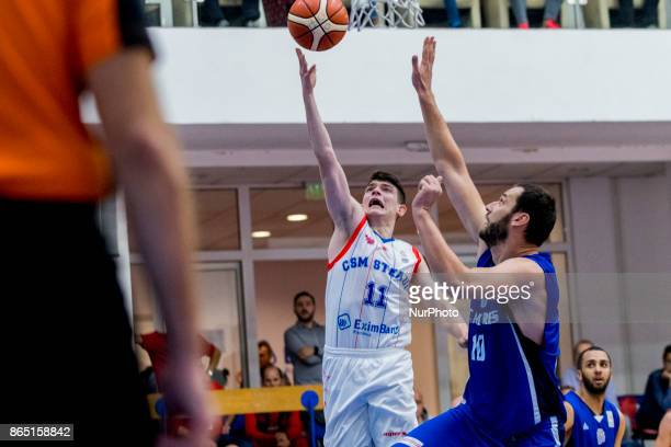 Georges Darwiche and Szabolcs Santa during the LNBM Men's National Basketball League game between CSM Steaua Bucharest and BC Mures TarguMures at...