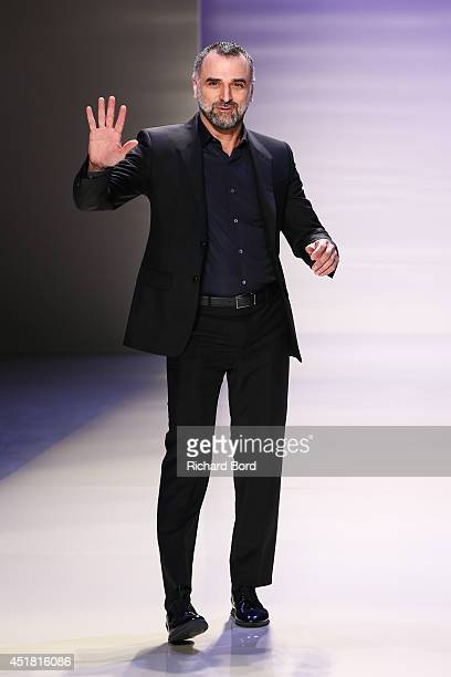 Georges Hobeika acknowledges the audience after the Georges Hobeika show as part of Paris Fashion Week Haute Couture Fall/Winter 20142015 at Les...