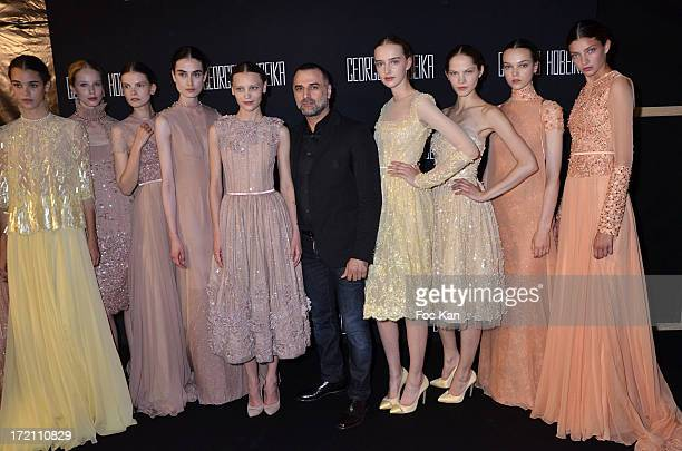 Georges Hobeika and his models pose at the finale of the Georges Hobeika show during Paris Fashion Week HauteCouture F/W 20132014 at Palais de Tokyo...