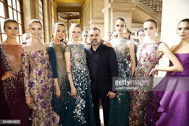 Georges Hobeika poses with models backstage during the Georges Hobeika Haute Couture Fall/Winter 20162017 show as part of Paris Fashion Week on at...