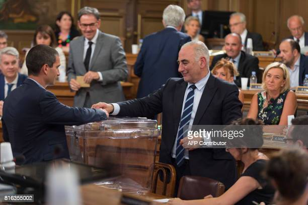 Georges Kepenekian votes to elect the new Mayor of Lyon during the city council at the city hall in Lyon central eastern France on July 17 2017 / AFP...