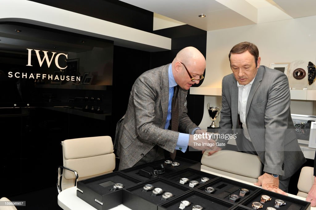 Georges Kern and <a gi-track='captionPersonalityLinkClicked' href=/galleries/search?phrase=Kevin+Spacey&family=editorial&specificpeople=202091 ng-click='$event.stopPropagation()'>Kevin Spacey</a> visit the IWC booth during the Salon International de la Haute Horlogerie (SIHH) 2013 at Palexpo on January 22, 2013 in Geneva, Switzerland.