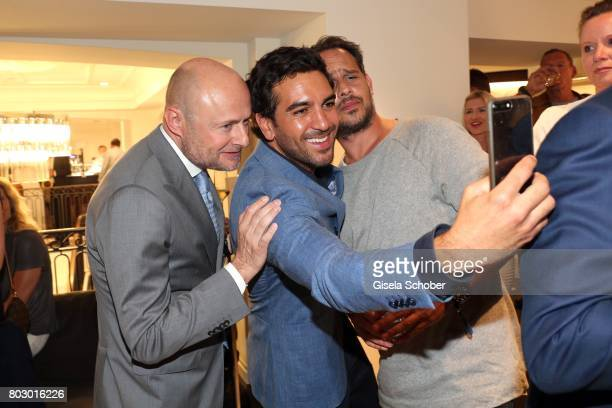 Georges Kern Head of Watchmaking Marketing and Digital Richemont Elyas M'Barek and Moritz Bleibtreu take a selfie during the exclusive grand opening...