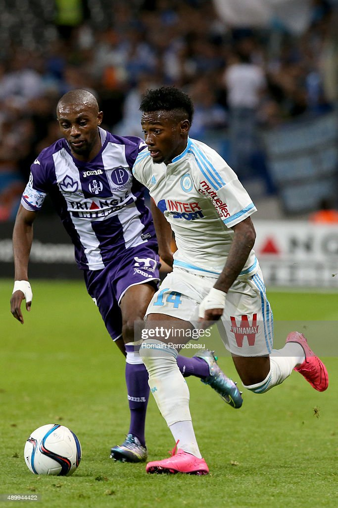Georges Kevin Nkoudou (R) for Olympique de Marseille and Jean Daniel Akpa Akpro during the French Ligue 1 game between Toulouse FC and Olympique de Marseille at Stadium Municipal on September 23, 2015 in Toulouse, France.