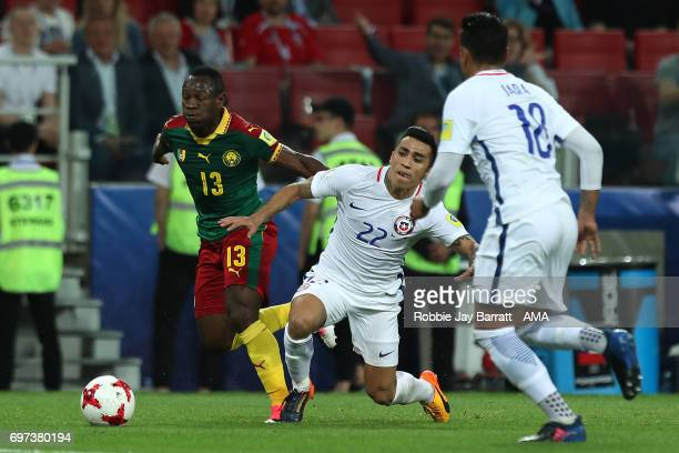 Georges Mandjeck of Cameroon competes with Edson Puch of Chile during the FIFA Confederations Cup Russia 2017 Group B match between Cameroon and...