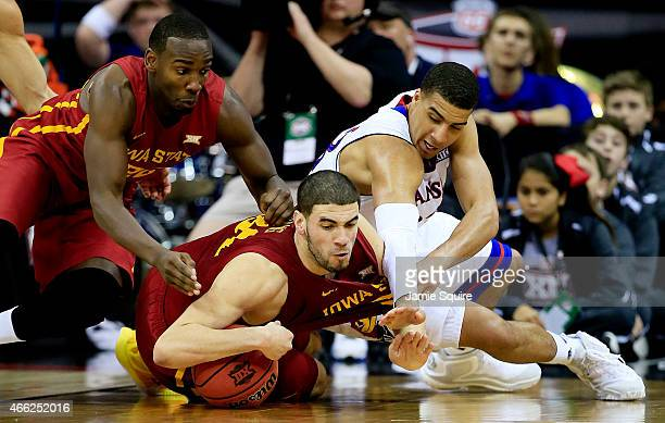Georges Niang and Dustin Hogue of the Iowa State Cyclones vie for a looseball with Landen Lucas of the Kansas Jayhawks in the second half during the...