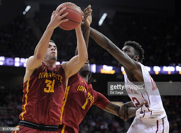 Georges Niang and Jameel McKay of the Iowa State Cyclones battle for the ball against Khadeem Lattin of the Oklahoma Sooners in the first half during...