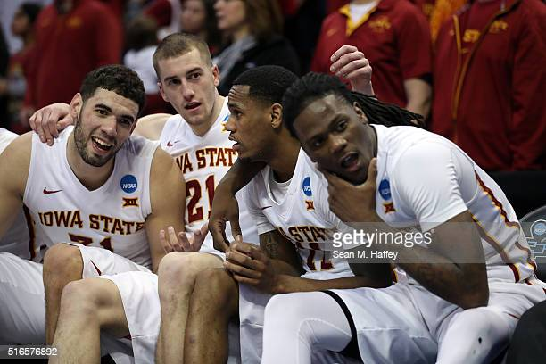 Georges Niang Matt Thomas Monte Morris and Jameel McKay of the Iowa State Cyclones celebrate from the bench late in the second half against the...