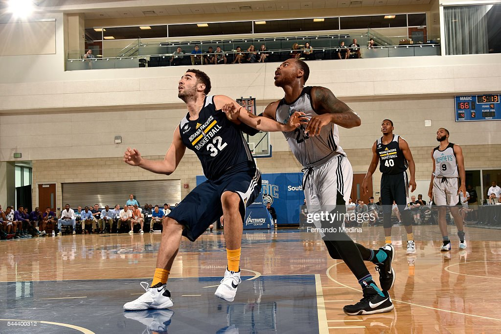 Georges Niang of Indiana Pacers boxes out against DeShaun Thomas of Charlotte Hornets during the game during the 2016 NBA Orlando Summer League on...