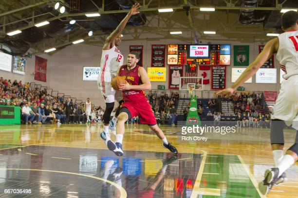 Georges Niang of the Ft Wayne Mad Ants drives past Jalen Jones of the Maine Red Claws on Monday April 10 2017 at the Portland Expo in Portland Maine...