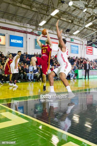 Georges Niang of the Ft Wayne Mad Ants looks for a shot against Guerschon Yabusele of the Maine Red Claws in Game 3 of their first round playoff...