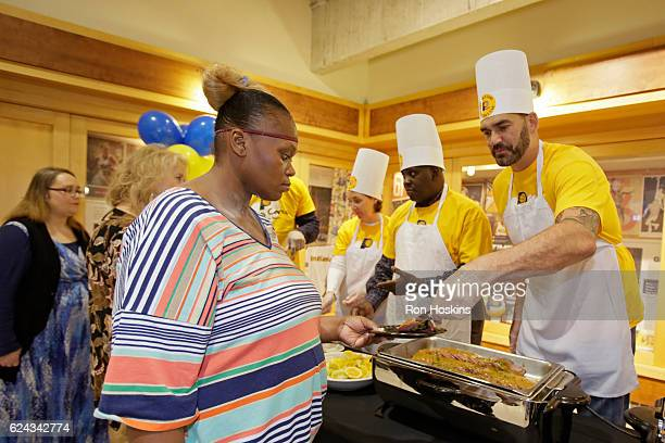 Georges Niang of the Indiana Pacers hands out food as they celebrate the Pacers Thanksgiving holiday event at Bankers Life Fieldhouse on November 17...