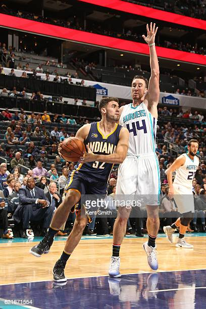Georges Niang of the Indiana Pacers looks to pass the ball against Frank Kaminsky III of the Charlotte Hornets during a game on November 7 2016 at...