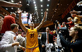 Georges Niang of the Iowa State Cyclones celebrates with fans after his team defeated the Kansas Jayhawks 8572 at Hilton Coliseum on January 25 2016...