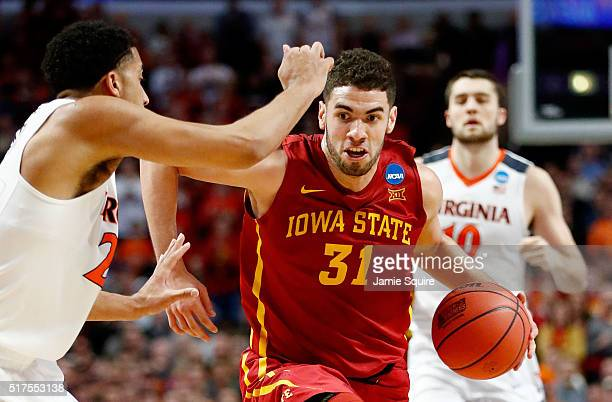 Georges Niang of the Iowa State Cyclones drives against Isaiah Wilkins of the Virginia Cavaliers in the second half during the 2016 NCAA Men's...