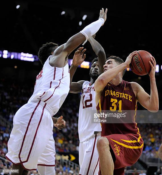 Georges Niang of the Iowa State Cyclones drives to the basket against Buddy Hield and Khadeem Lattin of the Oklahoma Sooners in the second half...