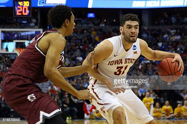 Georges Niang of the Iowa State Cyclones drives to the basket in the first half against Mareik Isom of the Arkansas Little Rock Trojans during the...