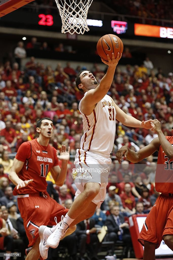 Georges Niang #31 of the Iowa State Cyclones lays up a shot as Dejan Kravic #11 of the Texas Tech Red Raiders defends in the first half of play at Hilton Coliseum on February 15, 2014 in Ames, Iowa.