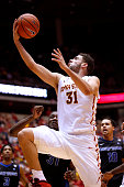 Georges Niang of the Iowa State Cyclones lays up a shot over Raheem Johnson and Jarryn Skeete of the Buffalo Bulls in the second half of play at...