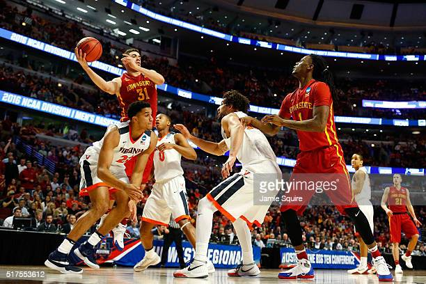 Georges Niang of the Iowa State Cyclones looks to pass against the Virginia Cavaliers in the second half during the 2016 NCAA Men's Basketball...