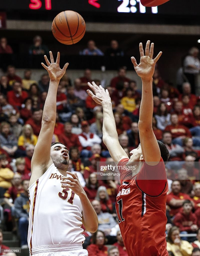 Georges Niang #31 of the Iowa State Cyclones puts up a shot over Dejan Kravic #11 of the Texas Tech Red Raiders in the first half of play at Hilton Coliseum on February 15, 2014 in Ames, Iowa. Iowa State defeated Texas Tech 70-64.