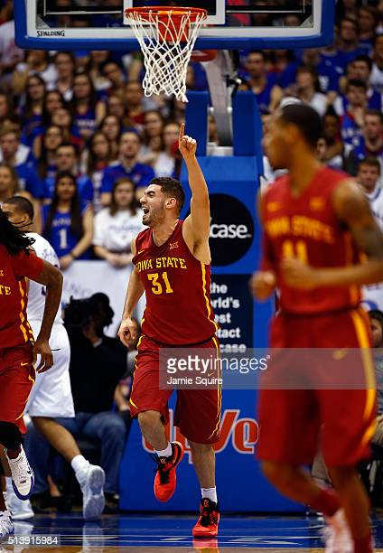 Georges Niang of the Iowa State Cyclones reacts after scoring during the game against the Kansas Jayhawks at Allen Fieldhouse on March 5 2016 in...