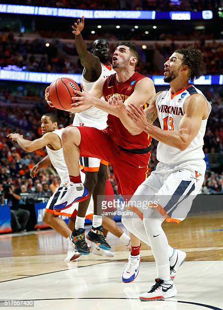 Georges Niang of the Iowa State Cyclones shoots against Anthony Gill of the Virginia Cavaliers in the second half during the 2016 NCAA Men's...