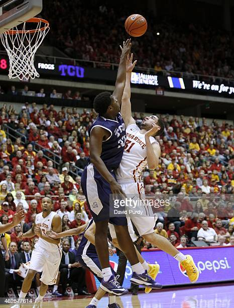 Georges Niang of the Iowa State Cyclones takes a shot over Chris Washburn of the TCU Horned Frogs in the first half of play at Hilton Coliseum on...