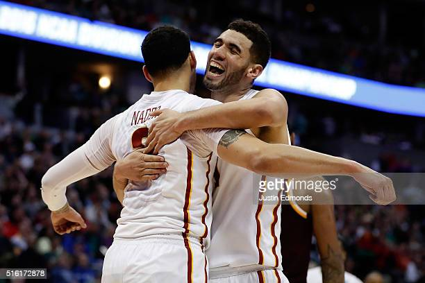 Georges Niang reacts with Abdel Nader of the Iowa State Cyclones after a basket against the Iona Gaels during the first round of the 2016 NCAA Men's...