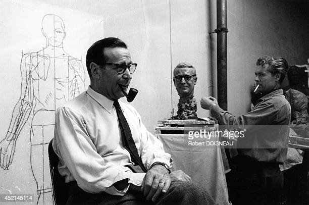 Georges Simenon at the Musee Grevin posing for his statue on September 4 1962 in Paris France