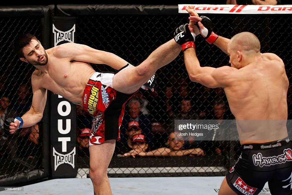 Georges St-Pierre blocks the kick of Carlos Condit in their welterweight title bout during UFC 154 on November 17, 2012 at the Bell Centre in Montreal, Canada.