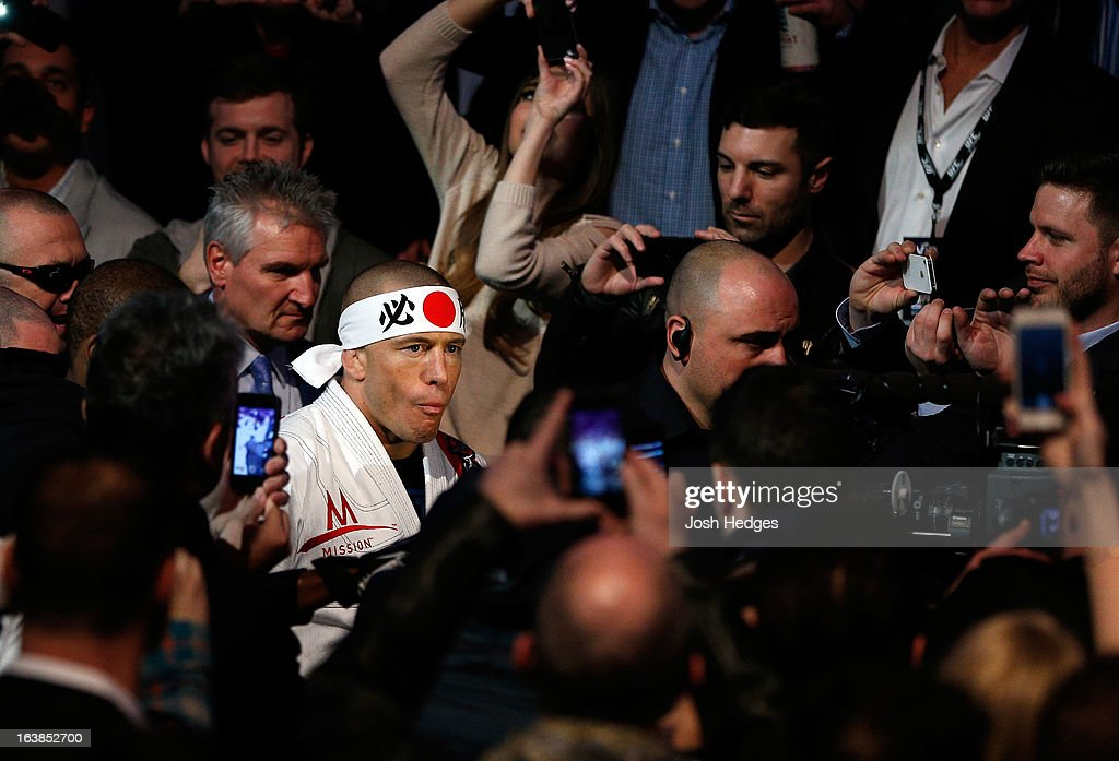 Georges St-Pierre enters the arena before his welterweight championship bout against Nick Diaz during the UFC 158 event at Bell Centre on March 16, 2013 in Montreal, Quebec, Canada.