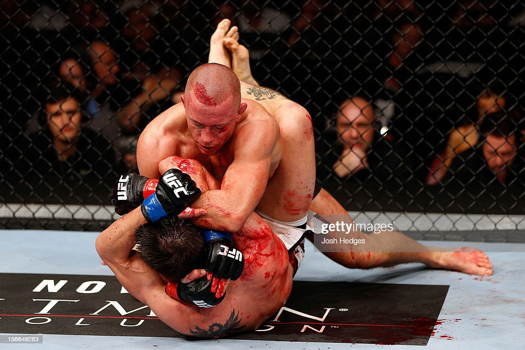 Georges St-Pierre (top) grapples against Carlos Condit in their welterweight title bout during UFC 154 on November 17, 2012 at the Bell Centre in Montreal, Canada.