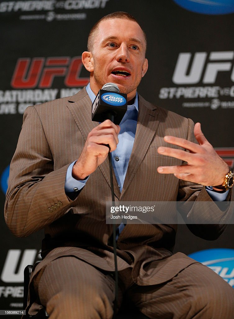 <a gi-track='captionPersonalityLinkClicked' href=/galleries/search?phrase=Georges+St-Pierre&family=editorial&specificpeople=4864241 ng-click='$event.stopPropagation()'>Georges St-Pierre</a> interacts with media and fans during the final pre-fight press conference ahead of UFC 154 at New City Gas on November 14, 2012 in Montreal, Quebec, Canada.